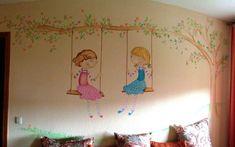 mural pintado de niñas en columpio