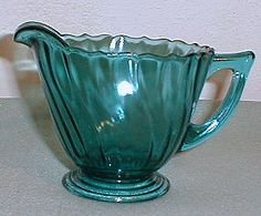 Pattern:   Swirl Depression Glass  Manufacturer:   Jeannette Glass Company