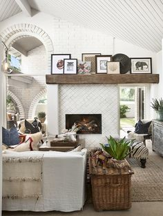 Thanks to the airy arches, rough-hewn mantel, and tile fireplace, this Arizona home feels like full-on desert country.