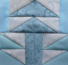 I have two remarks on this block: First, that I took a shortcut when sewing the tree top of the middle tree. Strictly speaking, the big blue triangles should each consist of two triangles half the ...