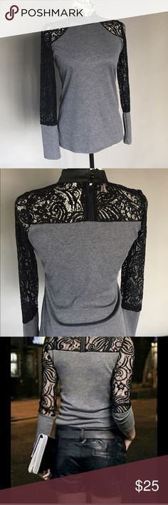 Cute lace top! Long sleeved knit and lace, black and grey top. Pair with cute shorts and heals for a fun evening out. I purchased from a boutique but it runs small and doesn't fit me. Says XL but fits as a large. To save anyone from the same situation I'm listing as a L. Tops