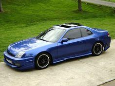 Blue Honda Prelude SH with black wheels