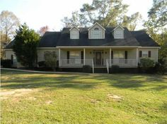 Completely Updated-5/3.5 Creole on 4.4 acres with a pond. New carpet, tile, paint-inside and out, fixtures,appliances, blinds, hot water heater etc. Enjoy the large front porch or screened in back porch!LR, foyer and hall have hardwood floors, woodburning FP, formal dining, and eat in kitchen. Kitchen w/SS appl, split brick flooring.Master with walk in closet, master bath with separate tub/shower. 2 Bedrooms up with media/sitting area and an office nook. Laundry room has 1/2 bath and sink…