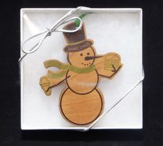 Color printed in a white box with clear lid and silver ribbon. Wooden Ornaments, Snowman Ornaments, How To Make Ornaments, White Box, Fort Collins, Ribbon, Printed, Unique, Holiday