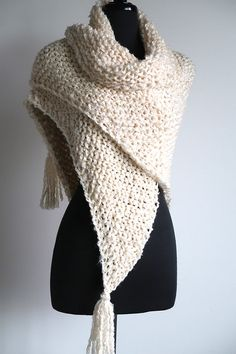 Relax in front of your fireplace and add some warmth to your life or give this gift of love to a close one. This shawl is lightweight, but very warm at the same time. It will keep you cozy on a cold day or night. I knitted this shawl from chunky, very soft acrylic yarn in beautiful light cream color. Measurements: Side to side length: approx.78 (198cm) without tassels Top to bottom length: approx.30 (76cm) without tassel  You can find more shawls here…