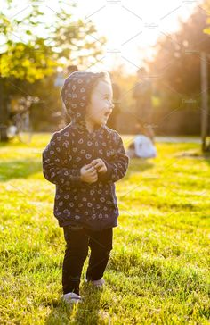 c2d5afcac Little baby girl plays in the park by Antonio Gravante Market on @creativemarket  Little Baby