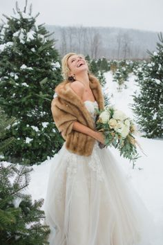 Winter Bride in Oleg Cassini Gown coat like this but obvi FAUX fur.