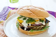 This Red Lentil Cauliflower Burger is loaded with onion, mixed greens, roasted yellow pepper and cilantro.