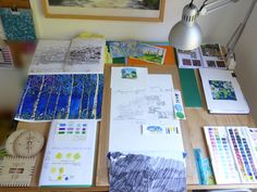 What's on my drawing board, Feb 07 2017. Top row: Sketchbook studies of houses. Cow parsley & daisy watercolour experiments using candles as a wax resist. Inspiration scrapbook. Middle row: Birch trees on shiny Bristol board - experimenting with layers of watercolour to build up texture. Test colour sketches of houses. White California poppies watercolour. Bottom row: Plywood Kumihimo disks I designed and made on my laser cutter. Sketchbook  colour sampling Pantone colour of the year…