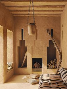 Sand and argil colors, with the shape of the windows, the fireplace and the side niches, plus the naturally texture of the wall painting, made this room an environment dominated by the earth element of feng shui. Interior Styling, Interior Decorating, Interior Design, Interior Architecture, Interior And Exterior, Adobe House, Natural Interior, Natural Building, Minimal Decor