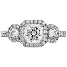 Integrity Three- Stone Engagement Ring. A vintage take on the classic three stone ring. This Hearts On Fire engagement ring features three Hearts On Fire diamonds encircled in pave halos, creating a unique look. BIG fan of this ring!
