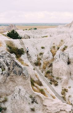 These steps to nowhere aren't as they appear. They're the steps of Notch Trail, one of the most beautiful but treacherous hikes in Badlands National Park in the Great Plains of South Dakota. South Dakota Vacation, South Dakota Travel, North Dakota, Places To Travel, Places To See, Badlands National Park, Adventure Is Out There, Vacation Spots, Vacation Ideas