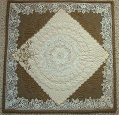 linens and lace quilt (too delicate for my home, for a dainty lady) Click and read the history of linen, lace. Much thanks to Cindy, who preserves old table cloths etc., making quilts which would be beautiful and probably seen more as a quilt than in a drawer, not used tablecloth.