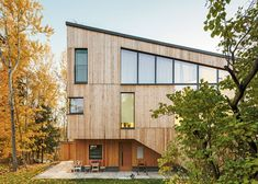 Timber-clad House M-M by Tuomas Siitonen wraps around a sheltered garden.