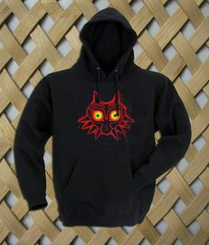 Zelda Majora Mask Hoodie  Hooded Sweatshirt  8.0 oz., 50/50 cotton/polyester Reduced pilling and softer air-jet spun yarn Double-lined hood with matching drawcord (adult style only) 1×1 athletic rib kint cuffs and waistband with spandex Double-needle stitching throughout Front pouch pocket. size: S,M,L,XL. color:black,gray,white,maroon.
