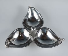 Nice Alfredo Sciarrotta hand-made sterling silver serving dish. Sciarrotta, born 1907, was a well established silversmith in Newport, Rhode Island during the late 1940's up until his death in 1985. This beautiful Art Deco triangular tray would be perfect for a table display of nuts or fruits because of its three sections.   eBay!