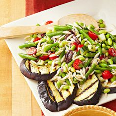 Embrace the bright flavors of the Mediterranean in our side-dish salad that features all your Greek food favorites (grilled eggplant, olives, tomatoes), plus a few unexpected ingredients (green beans, edamame, orzo pasta). The fresh and hearty recipe rings in at just 187 calories per serving.