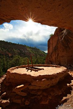 Kiva at Bandelier Natl. Monument- NM. The climb up to this Kiva is an adventure. In places the well-worn path in the rock has about a 6x4 inch ledge between you and the valley floor.