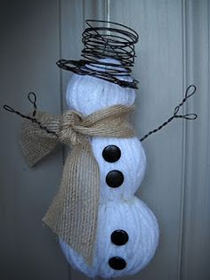 Snowman made from three different sized styrofoam balls, cut in half, and wrapped in white yarn.  Simple burlap scarf, wire hat and arms, and furniture tacks for buttons.