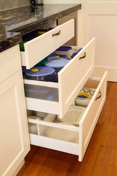 Traditional kitchen with deep drawers for practical plastic storage. www.thekitchendesigncentre.com.au