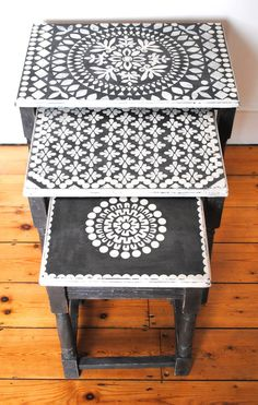 A nest of chalk painted tables with stencil designs. Which I was crafty enough to do this