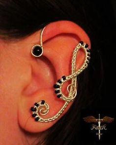Wire Ear Wraps by Alina Iftime / posted by ianbrooks. Music Jewelry, Ear Jewelry, Body Jewelry, Jewelry Art, Jewelry Design, Jewelry Making, Skull Jewelry, Hippie Jewelry, Jewlery