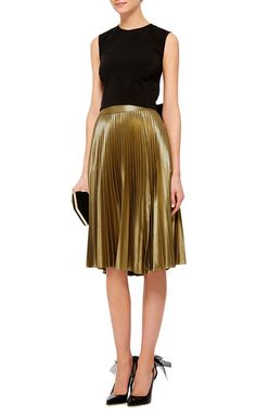 Designer Andrea Lieberman's contemporary aesthetic pays a sleek but subtle homage to Anita Pallenberg for Resort 2016. This **A.L.C.** skirt takes an urban spin to Pallenberg's insouciant '70s look, with delicate pleating in burnished gold.