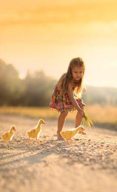 Little girl & the duckling race