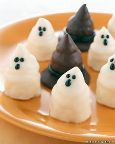 Ghoulish Petits Fours  -- i love these --  Elegant little bites of cake made into spooky ghosts and witches' hats.