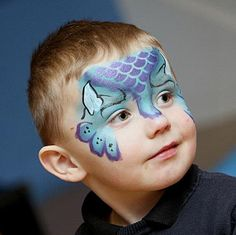 Blue dinosaur kids facepainting. This is definitely something new!