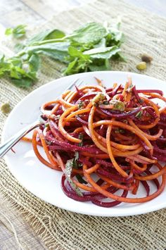 A spiralized beet salad that is tossed with a simple orange vinaigrette, fresh mint, and pistachios for the perfect light and healthy dish.