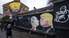 Image copyright                  AP                                                                          Image caption                                      Trump and Putin's warm words have been mocked by graffiti artists in Lithuania                                President-elect Donald Trump has dismissed the US threat to increase sanctions against Ru