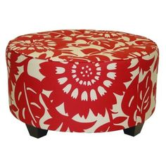 Pretty red round ottoman!  They will send you a free swatch - I got one, and love it!  The white is actually a nice cream that will work nicely with the curtains and the light fixture.  Can't wait!
