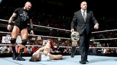 WWE COO Triple H takes away the WWE Championship from Daniel Bryan on Raw the evening after Night of Champions. Wwe Tna, Usa Network, Daniel Bryan, Randy Orton, Triple H, Wwe Wrestlers, Superstar, Champion, Hold On