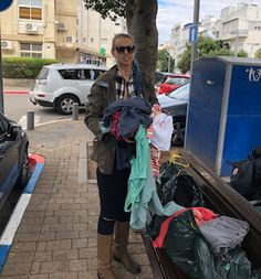 """Tel Aviv woman throwing away old clothes accidentally opens """"Pop-Up Store"""" ------------------------------------------ """"I was putting a handful of clothes on the bench near my house, and this woman just snatched a sweater out of my hand. I was about to scream at her. And then she handed me 20 Shekels. So it was OK…..Welcome to Tel Aviv."""" ------------------------------------------ #WelcomeToIsrael #TelAvivProblems #PopUpStore #StartupNation #TelAviv #Israel"""