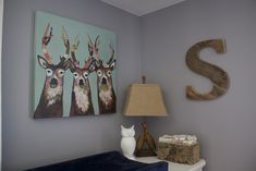 This is a stunning nursery done in woodland theme. Super cute fixtures!