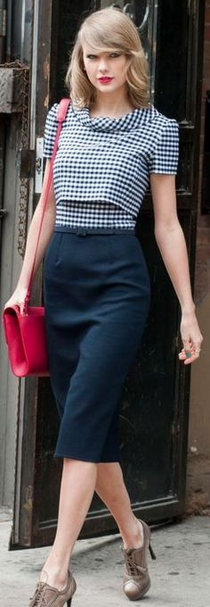 Who made  Taylor Swift's red handbag, tan suede lace up boots,  gingham turtleck top, and belted skirt that she wore in New York?