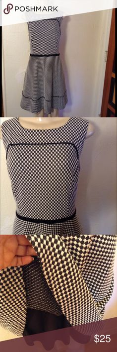 """Oleg Cassini Dress Cute black and white sweater dress.  A-line checkered with black piping. Lined and zipper in back.  Size 12, measures 20"""" bust, 18"""" waist, 39"""" length.  Machine washable.    In great condition.  Please use offer to negotiate, no holds and no trades.  I love bundles❤️! Oleg Cassini Dresses"""