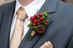 berries and pinecone boutonniere | see more fall wedding boutonnieres and corsages here: http://www.mywedding.com/articles/fall-wedding-boutonnieres-and-corsages/