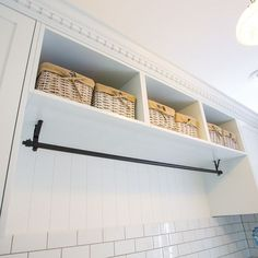 Bead board, nice hanging rod on top (high) and robe hooks underneath. Cabinets on the sides? Storage on top? Built in bench with shoe storage underneath. With washer and dryer stacked on one side... mud room and laundry room in a small space at it's most functional