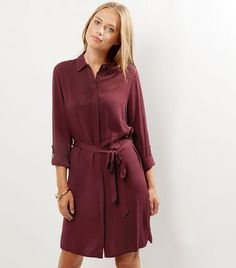 """Add this shirt dress to your everyday or work wardrobes. Complement with black heeled sandals.- Collared neck- Belted waist- 3/4 sleeves- Mini length- Button front fastening- Soft finish- Casual fit that is true to size- Erika is 5'9""""/175cm and wears UK 10/EU 38/US 6"""