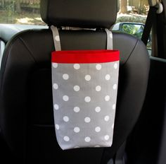 Car Trash Bag- for behind the headrest or on the gearshift handle. includes a stiff lining to hold a plastic bag in place