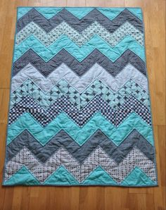 Make a trendy and chic quilt for your new grandbaby with this beginner quilting tutorial that uses the classic chevron pattern. This Baby Blue Chevron Quilt Tutorial shows you how to design a preppy in powder blue chevron quilt using budget-friendly