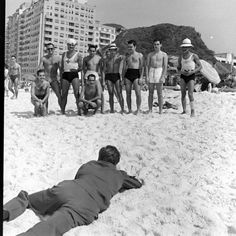 Walt Disney In Rio - 1941 Life Magazine. Would love to know why he's crawling on the beach.