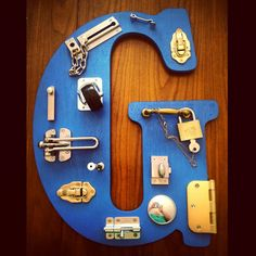 Photo inspiration for DIY busy latch board. No link & no tutorial, just the picture