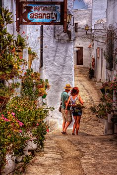 Couple walking down one of the narrow streets of Vejer de la Frontera, Spain