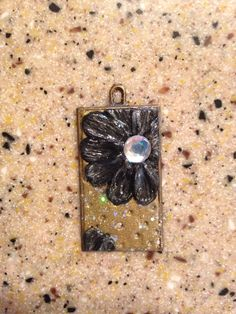 Floral pendant made from polymer clay