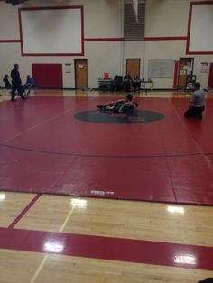 Jacob pins his opponent.