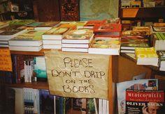 rainy day sign at OLD  HARBOR  BOOKS in Sitka, Alaska