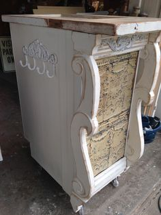 Moblie Stand. Use as a kitchen island,customer check out stand,mobile bar. Made from all salvaged materials, rescued kitchen cabinet,old door as counter top,pressed tin ceiling tile and architectural salvage. Best part, its on casters!. Designed and built by Junk Chic 5280